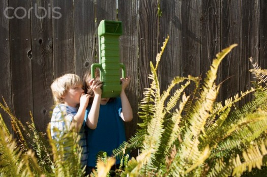 Two boys (8-9) looking through periscope
